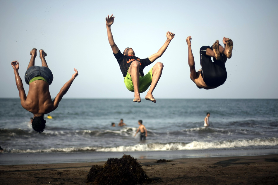 Yemen Boys Jump In The Air At The Beach In The Port City Of Hudaida, Southwest Of Sanaa, Yemen
